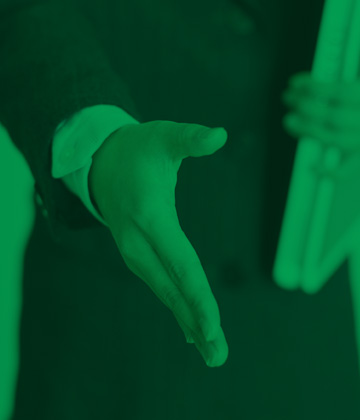 Photo of a person's hand being held out to shake