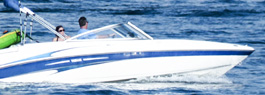 Photo of a white and blue boat on the water
